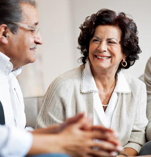mature woman smiling at family member