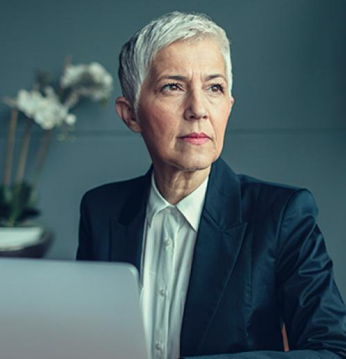 stoic businesswoman and computer